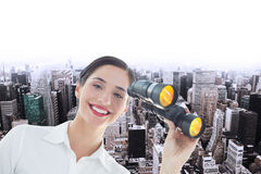 Composite image of smiling business woman with binoculars Stock Photography