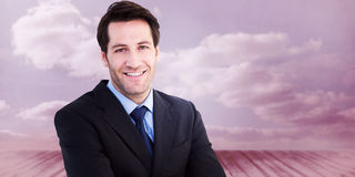 Composite image of smiling businessman with arms crossed Stock Photography