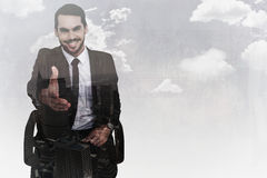 Composite image of smiling businessman on an chair office offering handshake Stock Photography