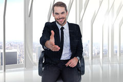 Composite image of smiling businessman on an chair office offering handshake Royalty Free Stock Photos