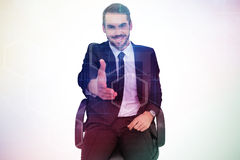 Composite image of smiling businessman on an chair office offering handshake Royalty Free Stock Image
