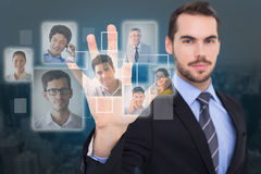 Composite image of smiling businessman with fingers spread out. Smiling businessman with fingers spread out against new york stock images