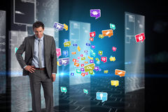Composite image of smiling businessman with hand on hip Stock Photos