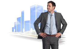 Composite image of smiling businessman with hands on hips Royalty Free Stock Photos