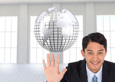 Composite image of smiling businessman holding hand up Royalty Free Stock Images