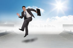 Composite image of smiling businessman in a hurry Stock Photos