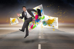 Composite image of smiling businessman in a hurry Stock Photography