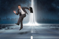 Composite image of smiling businessman in a hurry Royalty Free Stock Photography