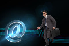 Composite image of smiling businessman in a hurry Stock Image