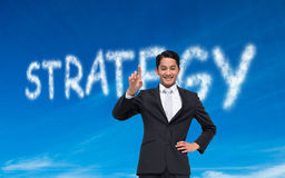 Composite image of smiling businessman pointing Stock Photography