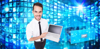 Composite image of smiling businessman pointing his laptop Royalty Free Stock Photography