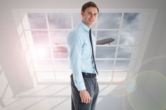 Composite image of smiling businessman standing with hand in pocket Royalty Free Stock Image