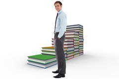 Composite image of smiling businessman standing with hands in pockets Royalty Free Stock Images