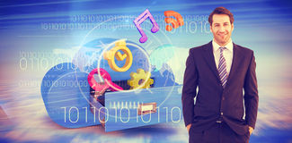 Composite image of smiling businessman standing with hands in pockets Stock Photo