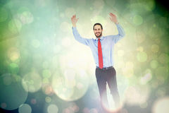 Composite image of smiling businessman stepping with hands raised Royalty Free Stock Image