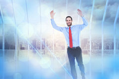 Composite image of smiling businessman stepping with hands raised Stock Photo
