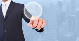Composite image of smiling businessman in suit pointing Stock Photo