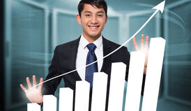 Composite image of smiling businessman touching Stock Image