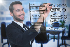 Composite image of smiling businessman writing with black marker Royalty Free Stock Photo
