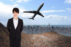 Composite image of smiling businesswoman. Smiling businesswoman against large city on the horizon Stock Images