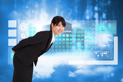 Composite image of smiling businesswoman bending Royalty Free Stock Images