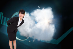 Composite image of smiling businesswoman bending Stock Image