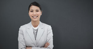 Composite image of smiling businesswoman with folded arms Stock Photography