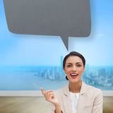 Composite image of smiling businesswoman holding a pen with speech bubble Stock Photo