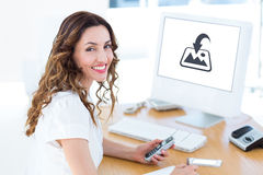 Composite image of smiling businesswoman looking at camera Royalty Free Stock Photos