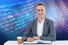 Composite image of smiling businesswoman looking at camera Stock Photography