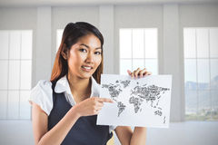 Composite image of smiling businesswoman pointing a sheet of paper Stock Images