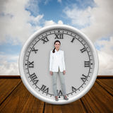 Composite image of smiling businesswoman standing straight up Stock Photography
