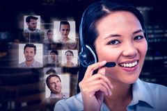 Composite image of smiling businesswoman using headset Stock Photography