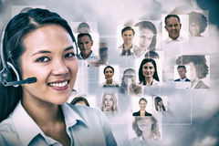 Composite image of smiling businesswoman using headset Royalty Free Stock Photography