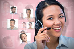 Composite image of smiling businesswoman using headset Royalty Free Stock Images