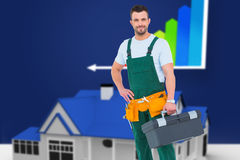 Composite image of smiling carpenter with toolbox Royalty Free Stock Photos