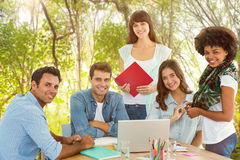 Composite image of smiling casual colleagues in a meeting Royalty Free Stock Photo