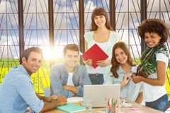 Composite image of smiling casual colleagues in a meeting Stock Photo