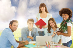 Composite image of smiling casual colleagues in a meeting Royalty Free Stock Photos