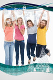 Composite image of smiling celebrating girls jumping up Royalty Free Stock Images