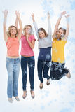 Composite image of smiling celebrating girls jumping up royalty free stock photo