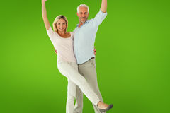 Composite image of smiling couple cheering at the camera Stock Photos