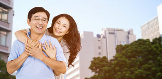 Composite image of smiling couple holding each other Stock Image
