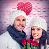 Composite image of smiling couple holding roses bouquet Stock Images