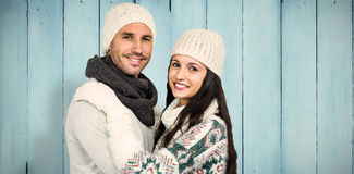 Composite image of smiling couple hugging and looking at camera Stock Photos