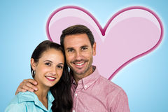 Composite image of smiling couple looking at camera Stock Photo