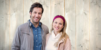 Composite image of smiling couple looking at camera Royalty Free Stock Images