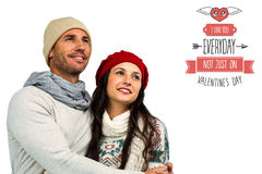 Composite image of smiling couple looking up Royalty Free Stock Photo
