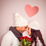 Composite image of smiling couple nose-to-nose holding roses bouquet Stock Photography
