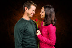 Composite image of smiling couple with red rose Royalty Free Stock Photos